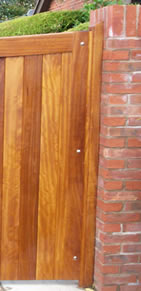 Hardwood stile attached to brick pillar